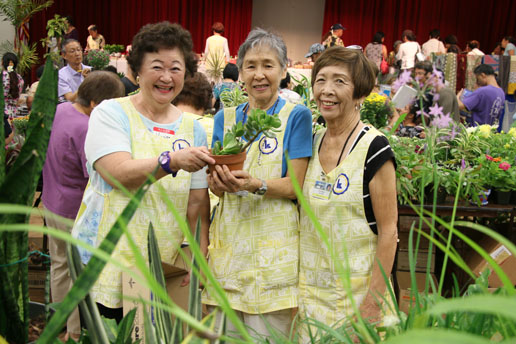 Volunteers show off plants for sale at last year's Kuakini Bazaar. (Photo from kuakini.org)
