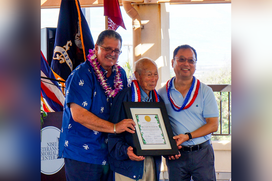 Photo of Maui County Councilman Mike Victorino presents a certificate to Hiroshi Arisumi (center) and Brian Moto, representing the Maui AJA Veterans, Inc.