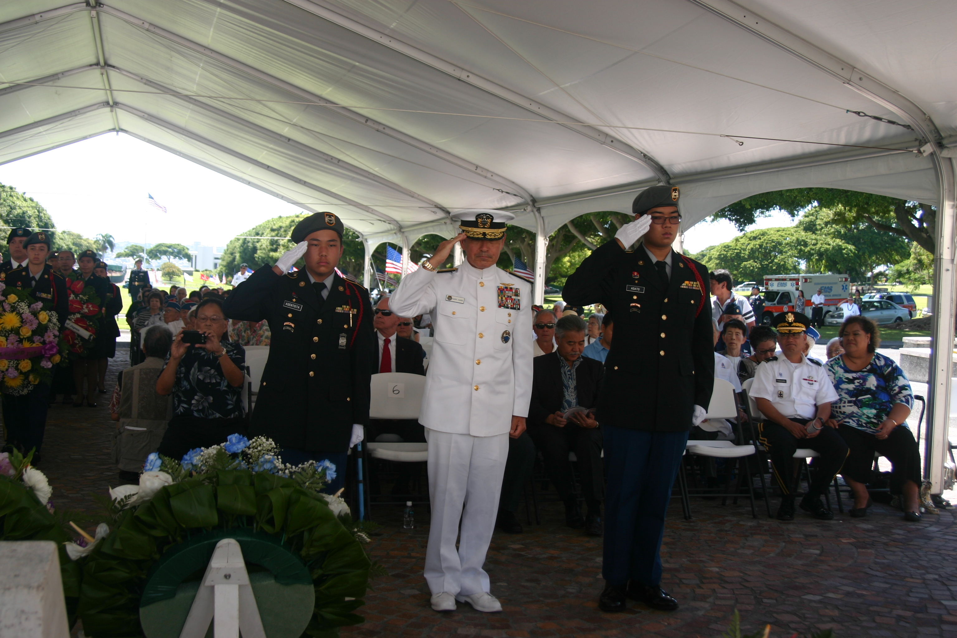 Photo of Adm. Harry B. Harris Jr., who commands the U.S. Pacific Command, salutes the World War II AJA soldiers after placing his wreath at the memorial.