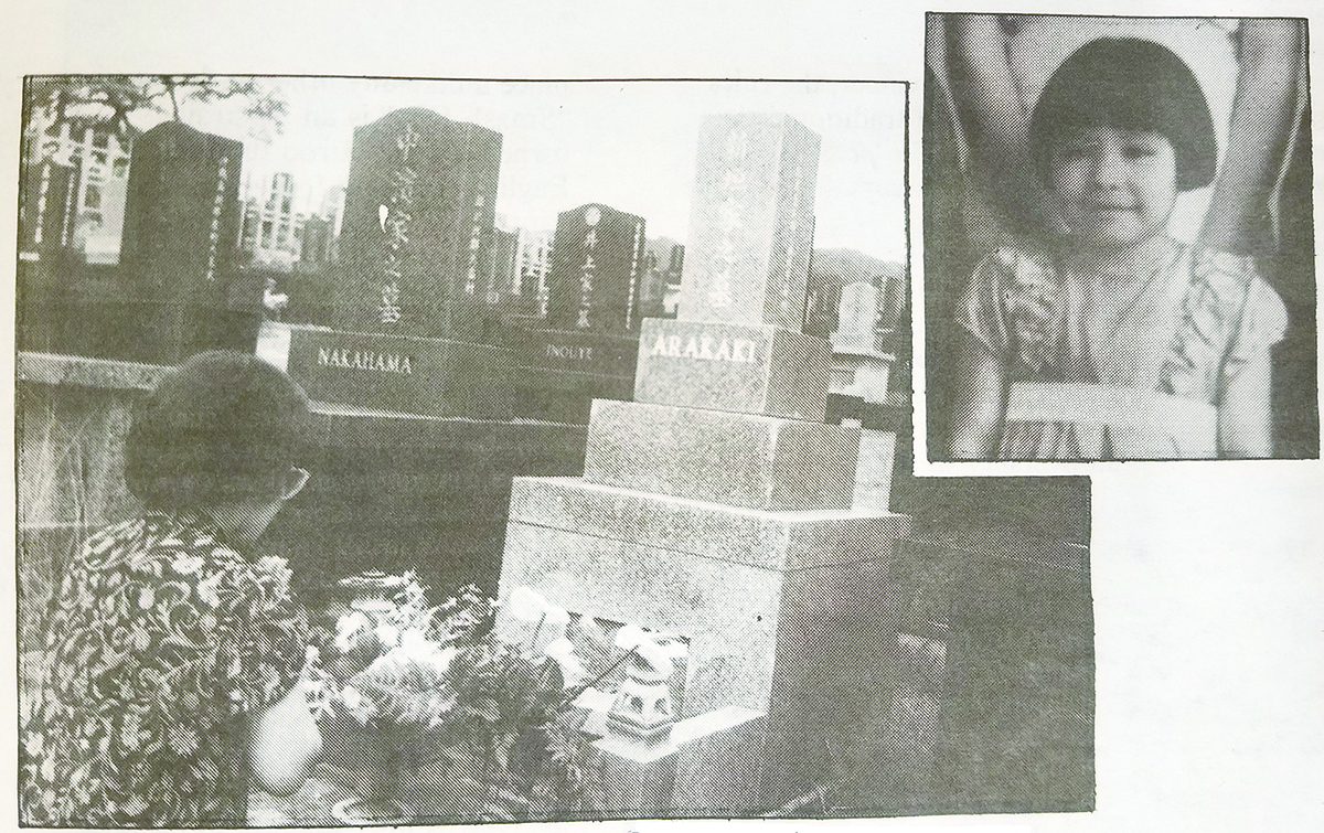Photo of June Arakawa prays at the grave of her sister Nancy Masako Arakaki.