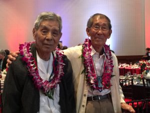 """Photo of 100th Infantry Battalion veterans Rikio Tsuda and Coolidge Wakai at the """"Fighting Two Wars"""" banquet."""