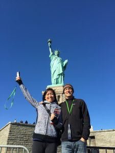 Photo of Meredith and her boyfriend, Franz, posing in front of the Statue of Liberty