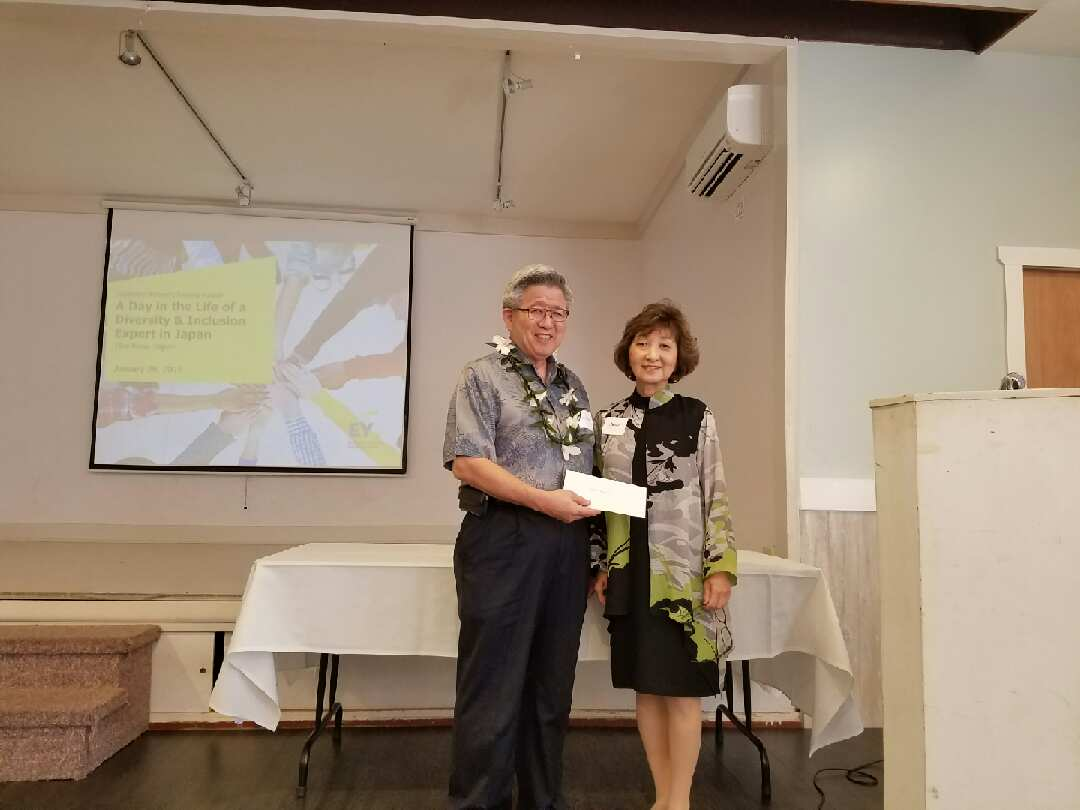 Photo of JWSF president-elect Cathy Iwai presents a check for $10,000 to Kuakini Foundation president Gary Kajiwara for Kuakini Home