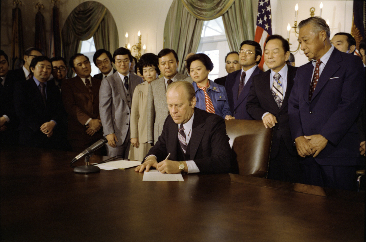 "Photo of Gerald R. Ford back in 1976 as he signs ""An American Promise,"" officially repealing Executive Order 9066."