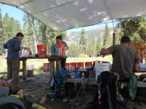 Photo of supplies and campsite, in joint with hikers who befriended Keiri