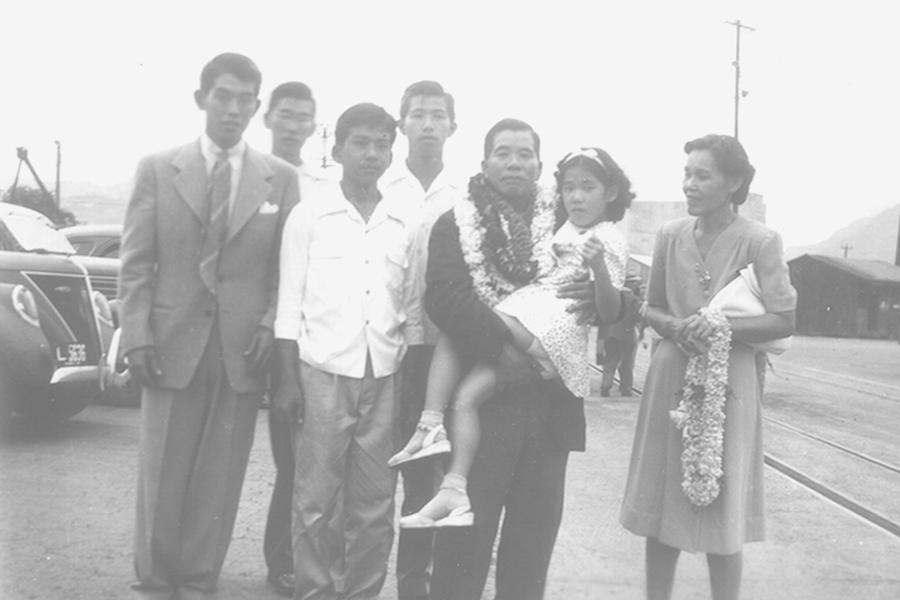 Photo of Kumaji Furuya's entire family greeting him at Honolulu Harbor when he arrived home on Nov. 13, 1945