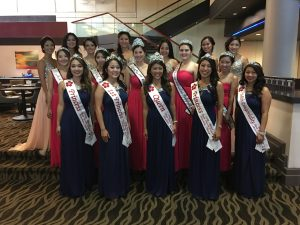 Photo of the three sister courts gathering for a group photo while attending the 76th Nisei Week coronation in Los Angeles.