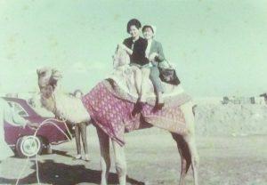 Photo of Lillian Seki and Sheila Matsuda enjoy a camel ride in New Delhi, India.