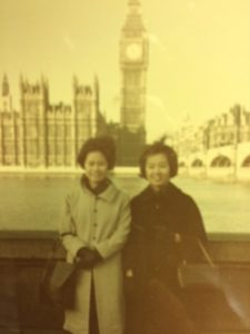Photo of Yoko Yamamoto and Betty Shimogawa (today Santoki) in London with Big Ben, the House of Parliament and the Thames River in the background.