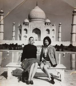 Photo of Joan Covington and Marilyn Takeuchi with the Taj Mahal in the background.