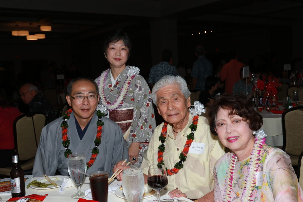 Photo of Consul General of Japan Yasushi Misawa and his wife Yoko enjoying time with former Hawai'i Gov. — and MIS veteran — George Ariyoshi and his wife Jean at the March 9 Nisei Veterans Legacy fundraiser.