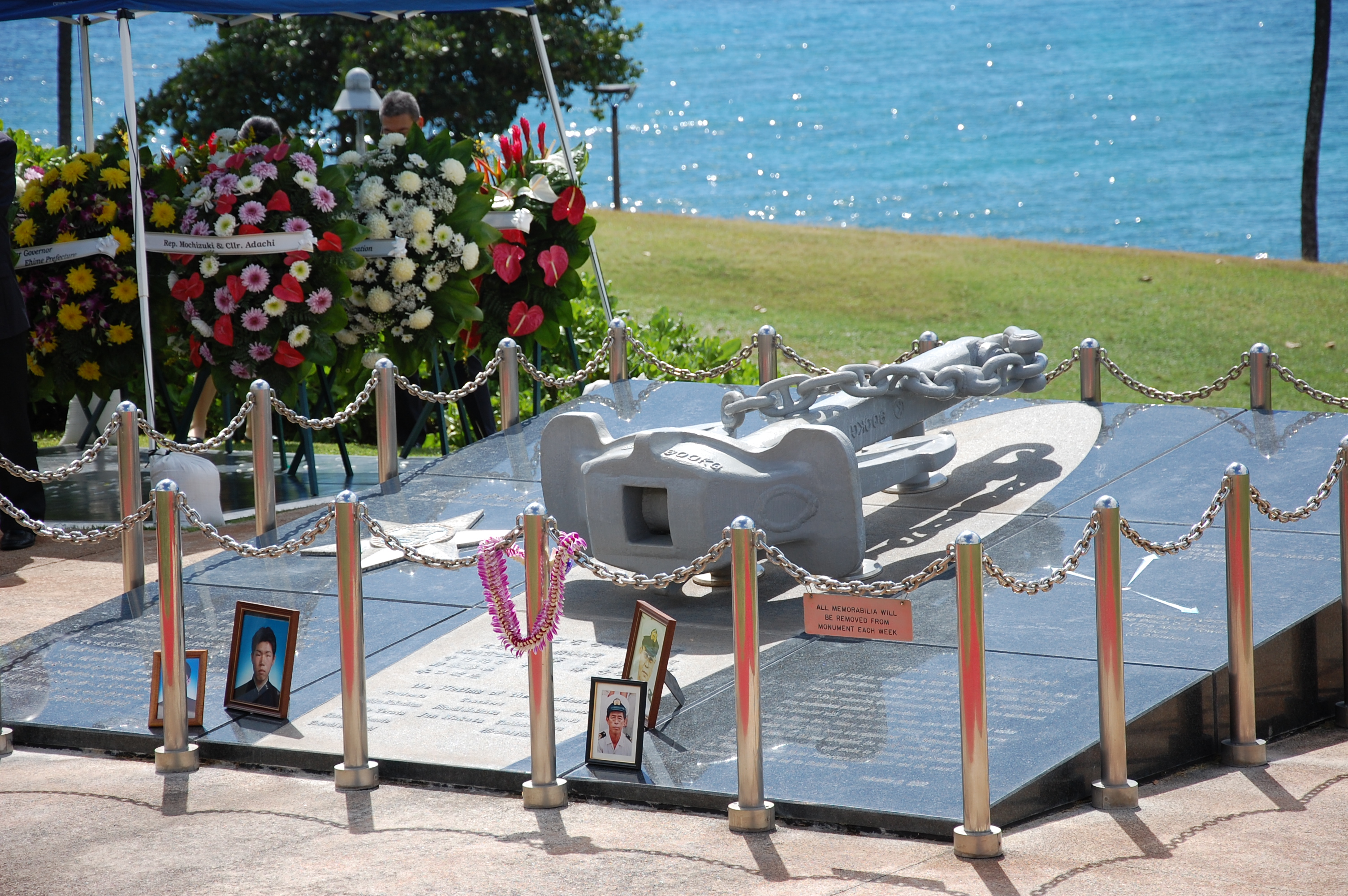Wreaths offered by government officials and community groups surround the Ehime Maru Memorial at Kaka'ako Waterfront Park.