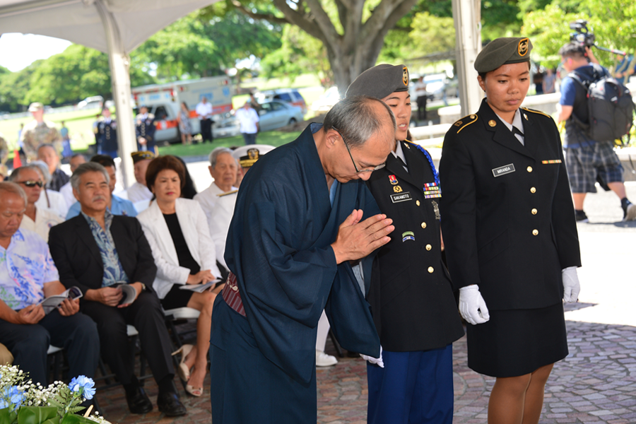 Photo of Consul General Misawa offers a prayer in memory of the World War II Nisei soldiers at last September's Joint Memorial Service at the National Memorial Cemetery of the Pacific at Punchbowl. (Photos courtesy Ann Kabasawa)