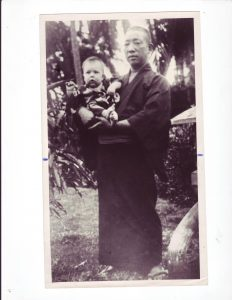"Photo of Professor Henry Seishiro Okazaki cradles the ""miracle"" baby who was given his Japanese name, Seishiro."