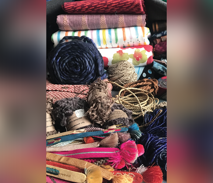 Photo of crafts for the 'Temari Bolts Fundraiser' featuring a market of textile and fabric items