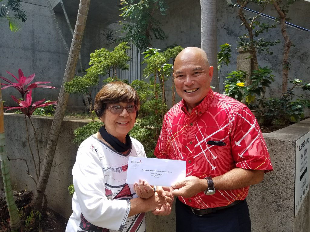First prize winner Betty Higa with Richard Oshiro, Island Air vice president of sales and marketing.