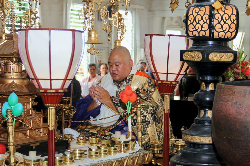 Photo of Rev. Clar Watanabe - doing a service in temple