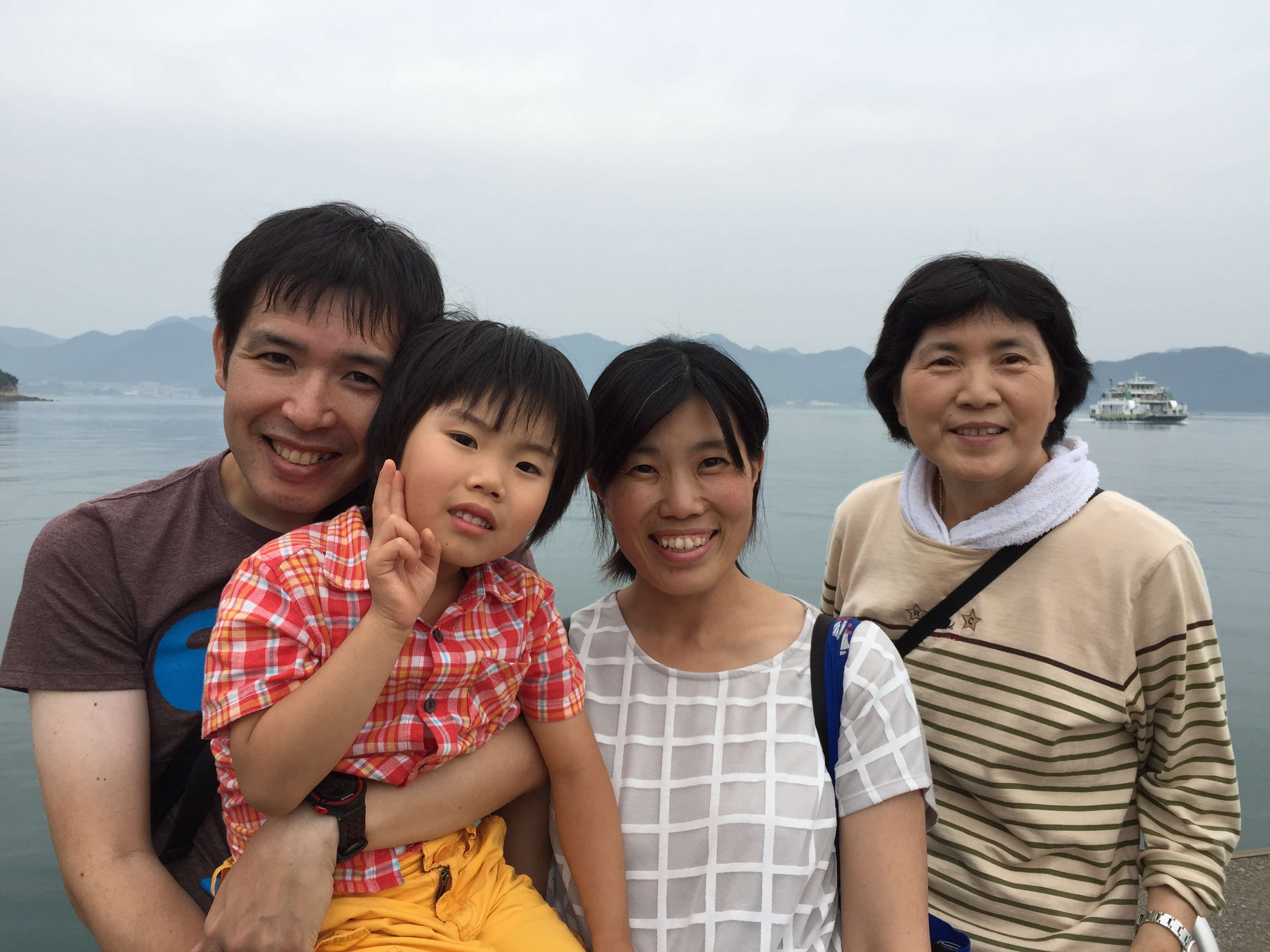 Group photo of the Araragis family - Keisuke, Shogo, Reiko, and Teruko Kawachika (Reiko's mother) on Okunoshima waiting for the ferry back to Hiroshima