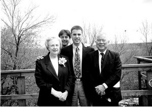 """A 1995 family photo of Mary and Edwin """"Bud"""" Nakasone with their two sons, Paul (standing between them) and John behind Paul. (Photos courtesy Lt. Gen. Paul Nakasone)"""