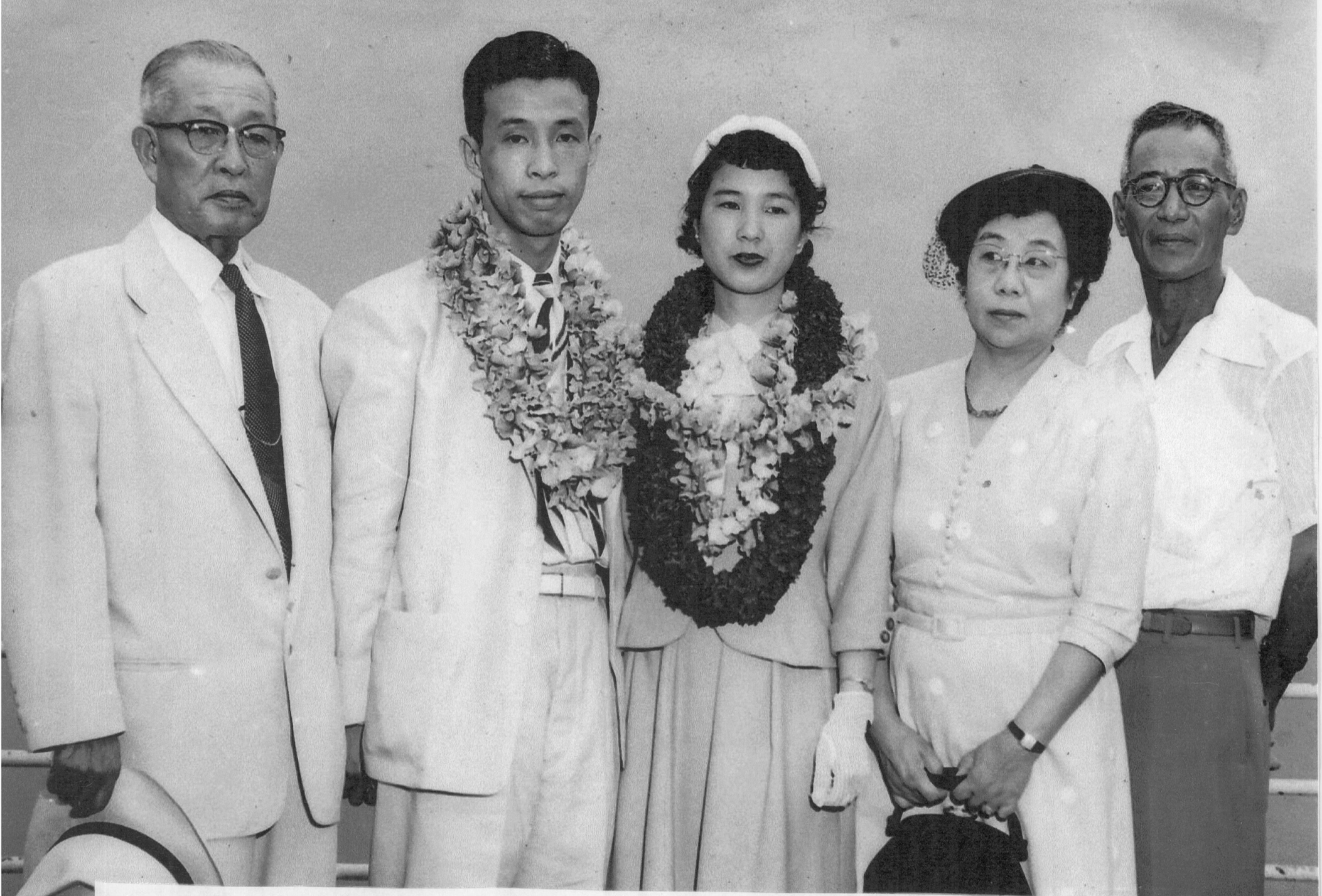 Takao and Misayo Nihei (wearing lei) are greeted at Honolulu Harbor in 1956 by Honolulu Sake Brewing Co., Ltd. president Daizo Sumida (far left), his wife Fusao Sumida; and Susumu Nomura, Honolulu Sake's director of operations. (Photos courtesy Misayo Nihei)