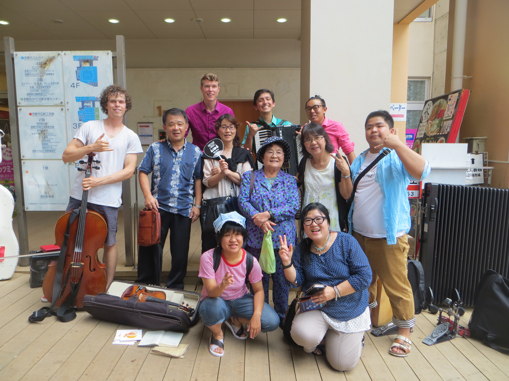 Group photo of Jesse Shiroma's relatives in Okinawa with the band, Streetlight Cadence