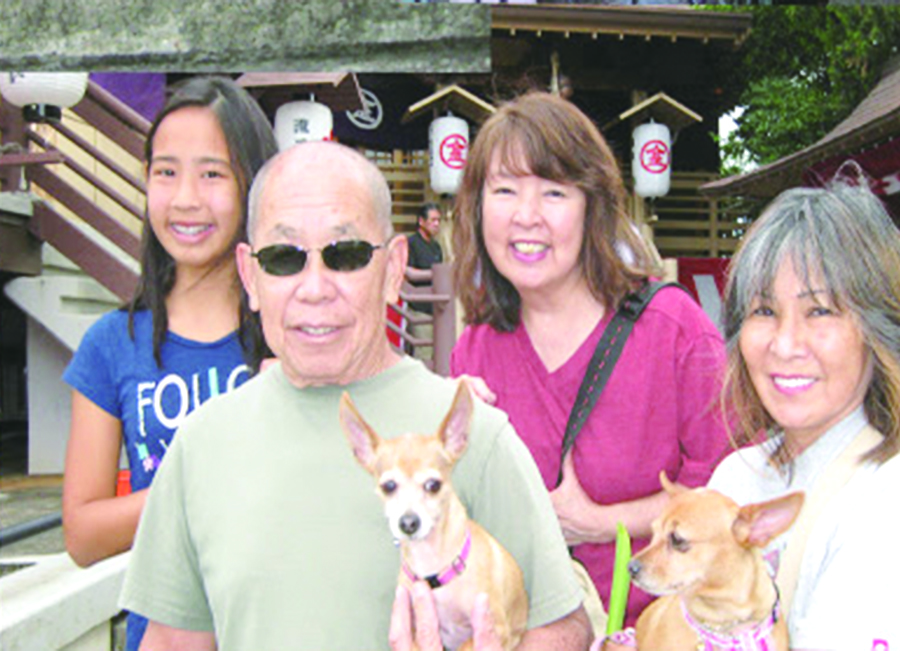 Photo of a family attending a Chinowa blessing for people and pets