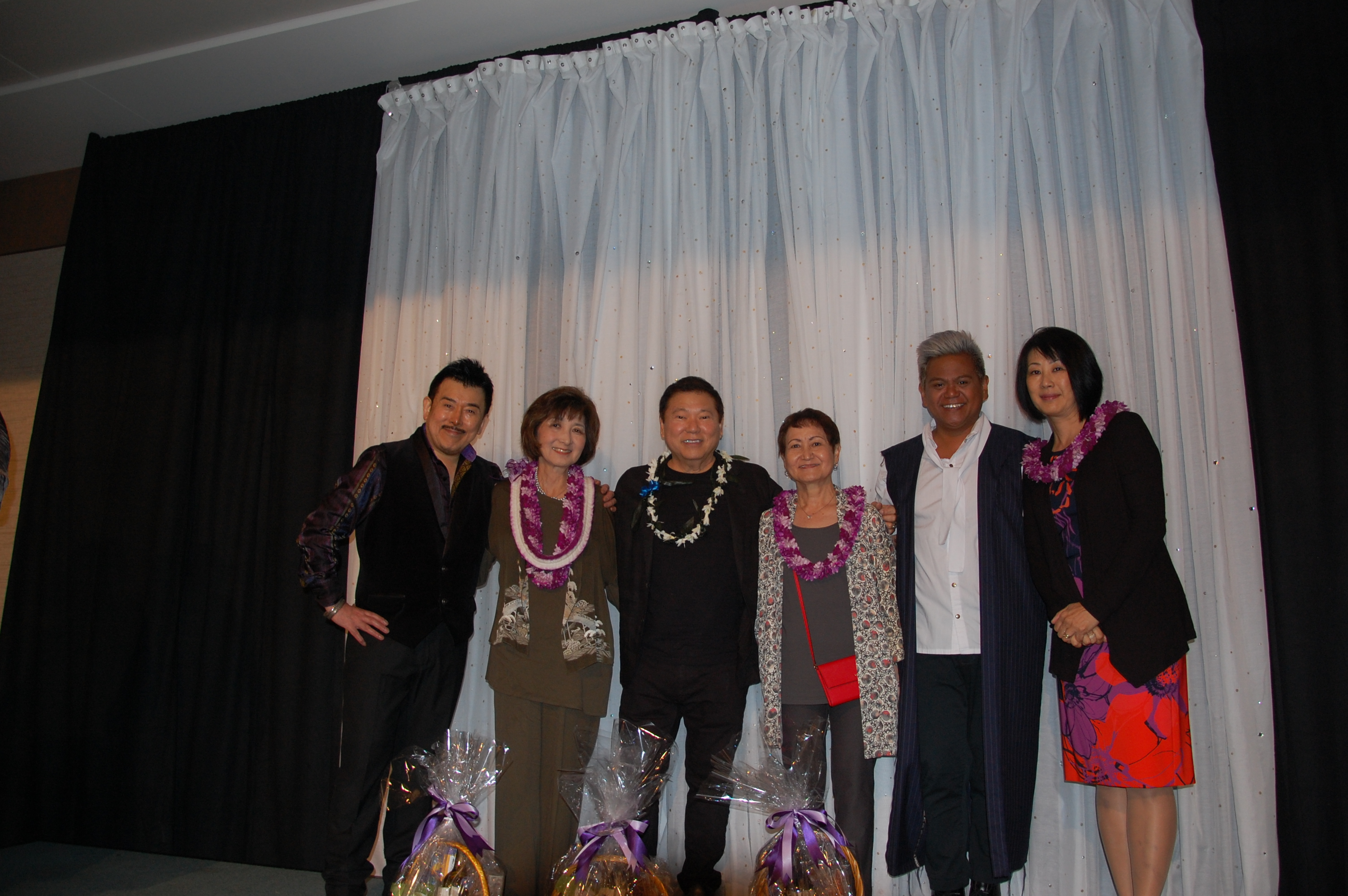"The fashion show co-chairs with featured designers of ""Kagirinaki Yume (Boundless Dreams),"" the 37th fashion show presented by the Japanese Women's Society Foundation. From left; Kensei Takeda, Cathy Iwai, Amos Kotomori, Suzette Lau Hee, Kini Zamora and Hiroko Dewitz."