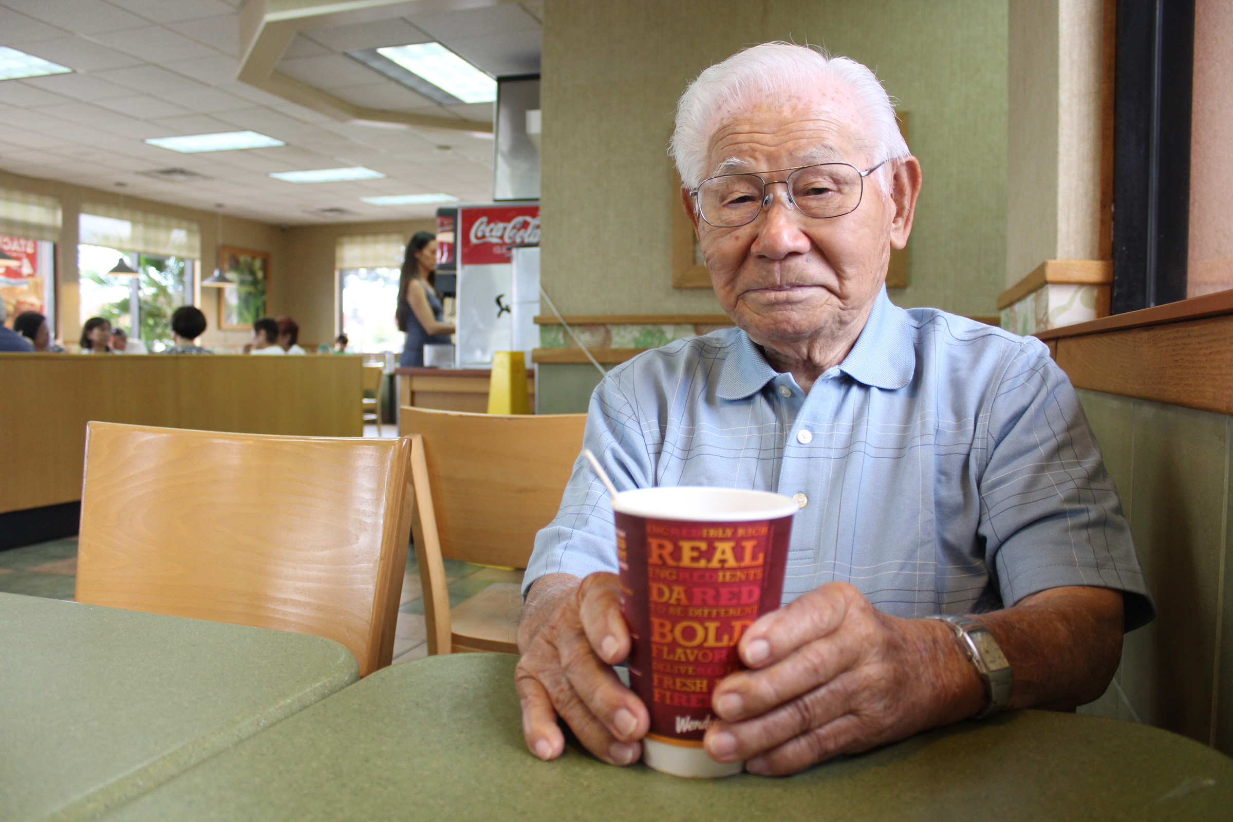 Centenarian Dr. Seiya Ohata enjoying a cup of coffee at the Wendy's in Kahului recently. (Photo by Colleen Uechi)