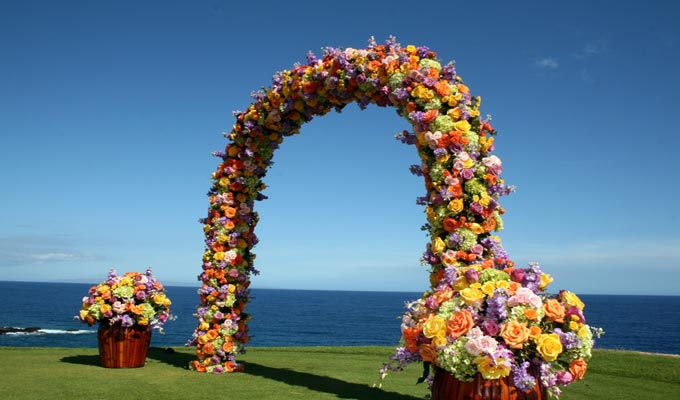 Photo of a floral wedding arch by Asa Ige. (Courtesy hawaiiweddinglove.com)