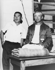 Coach Soichi Sakamoto in 1960 with one of his best Three-Year Swim Club achievers, Keo Nakama. In 1961, Nakama became the first person to swim the entire 27-mile Ka Iwi Channel from Moloka'i to O'ahu.