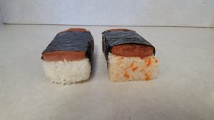 """Miyako Sushi produces a Spam musubi as well its original """"Spam musunari,"""" which uses the rice of the inarizushi with a slice of Spam."""