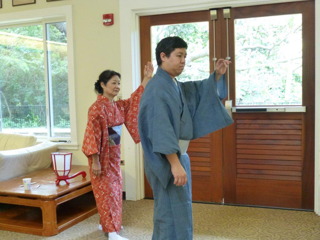 "Jimpu Kai USA Kin Ryosho Ryukyu Geino Kenkyusho Hawaii Shibu artistic director Cheryl Nakasone runs through movements from ""Shushin Kani'iri"" with student Corey Zukeran"