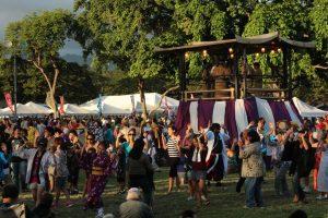 Photo of attendees enjoying a bon dance at a past Okinawan Festival