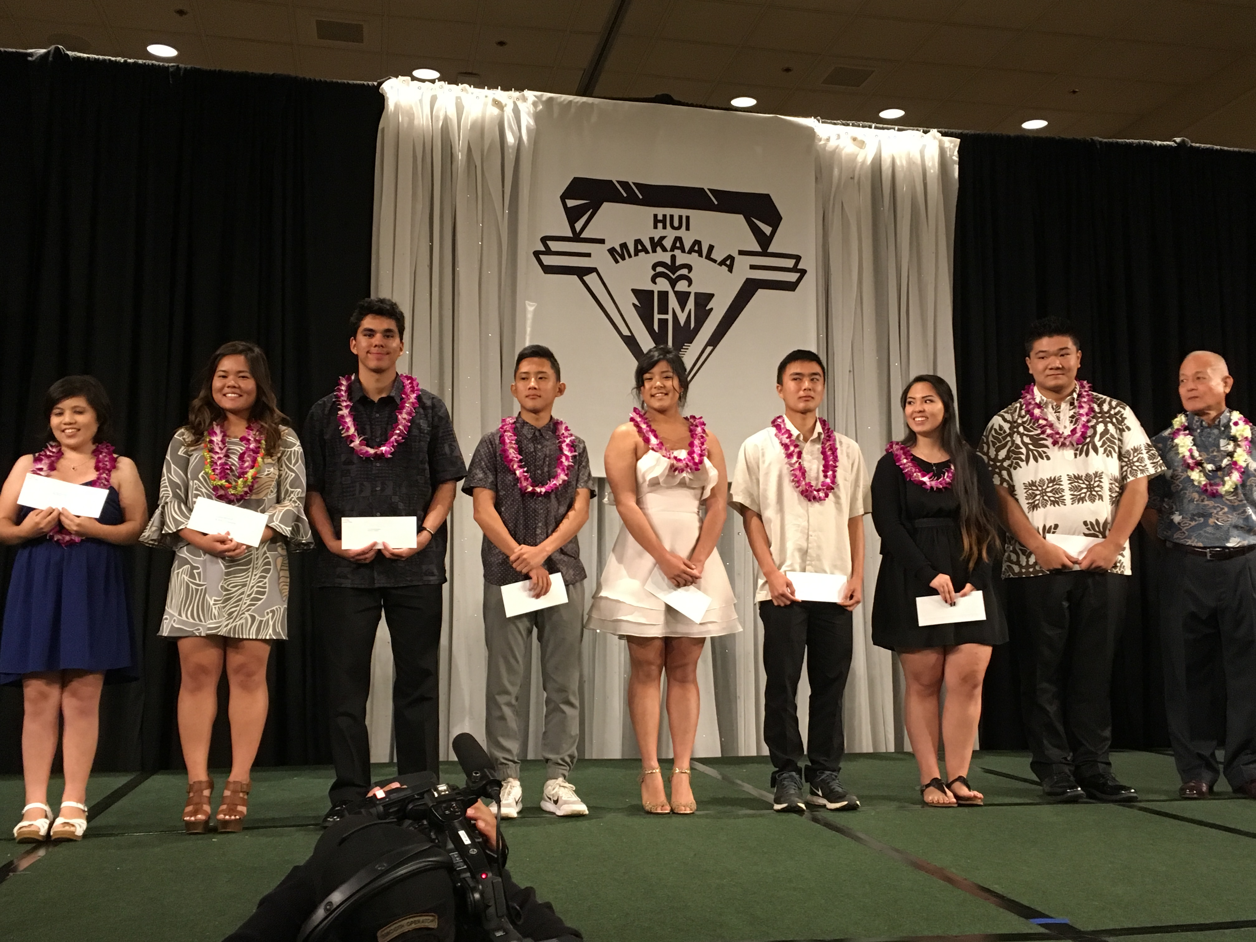 The 2017 Hui Makaala scholarship recipients were recognized at the scholarship fashion show luncheon. They are from left: Briana Campbell, Nikki Chinen, David-John Fernandez, Treyson Furuta, Emma Kojima, Cheyne Tanoue, Kiaria Zoi Nakamura and Dane Yamashiro. Pictured with them is Hui Makaala president Clayton Uza (far right). Not pictured: Sydney Tsukenjo.
