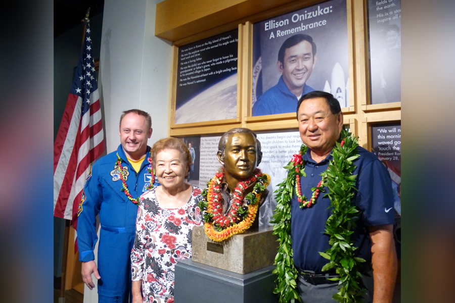 Onizuka siblings Claude Onizuka and Shirley Matsuoka and astronaut Col. Edward Michael Fincke of the NASA astronaut office at the bust of Ellison Onizuka on his 71st birthday, which was marked by the opening of the Ellison Onizuka Remembrance at JCCH.