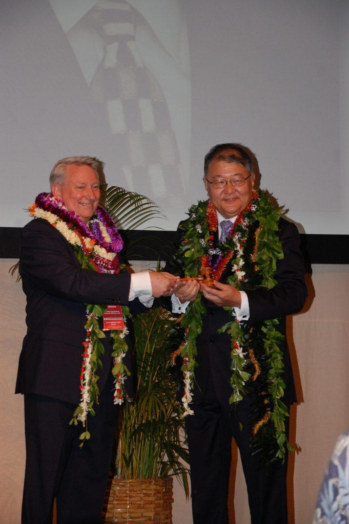 Dave Erdman (left) passes the gavel to Brian Nishida, officially turning over the reins of leadership to Nishida.