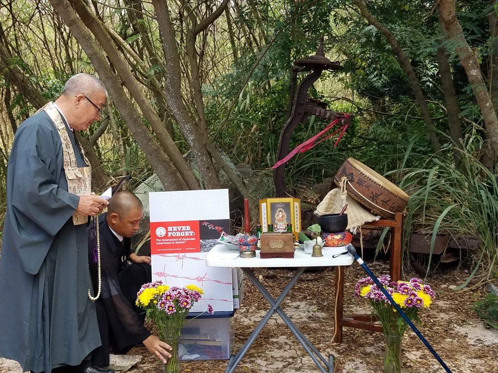 Bishop Shugen Komagata and his son, the Rev. Shuji Komagata, prepare for the obon service at Honouliuli National Monument. The taiko drum found at Nichiren Mission of Hawaii is to the right.