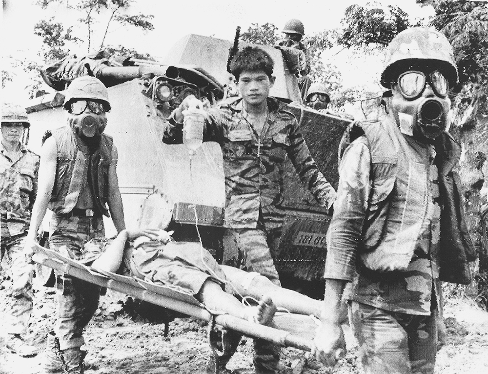 Old photo of soldiers carrying the injured during Vietnam War