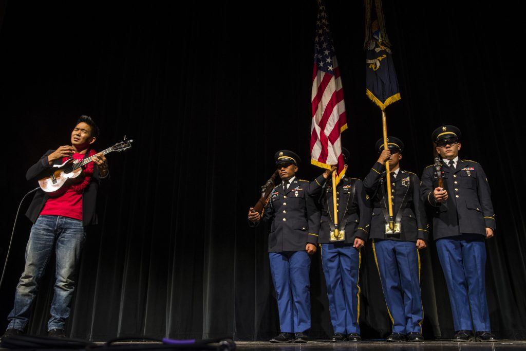 The color guard of the 100th Battalion, 442nd Infantry Regiment stands at attention as 'ukulele virtuoso Jake Shimabukuro performs the national anthem at the Hawaii Theatre preview.