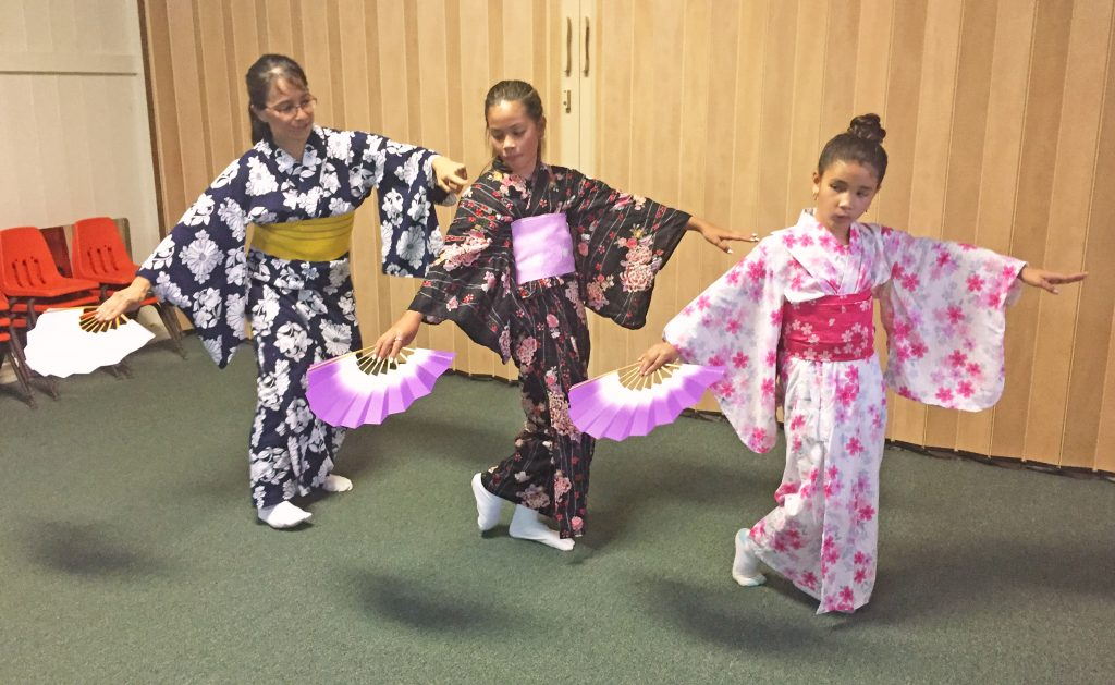 Azuma Kikusue-Sensei corrects the arm positions of 12-year-old Madison Doo and 8-year-old Skye Schumacher. (Photos courtesy Azuma Kikusue-Sensei)