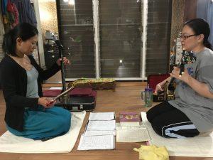 Allison Yanagi-Sensei (right) plays sanshin while her student Yukiko Pierce practices kücho during a recent lesson. (Photos courtesy Allison Yanagi)