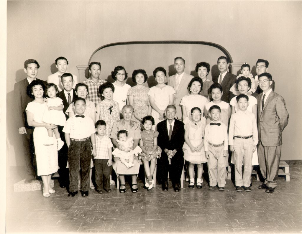 With eight surviving children, Hide and Aijurö Kurasaki's family grew bigger as their children married and started their own families, as seen in this 1960s family portrait.