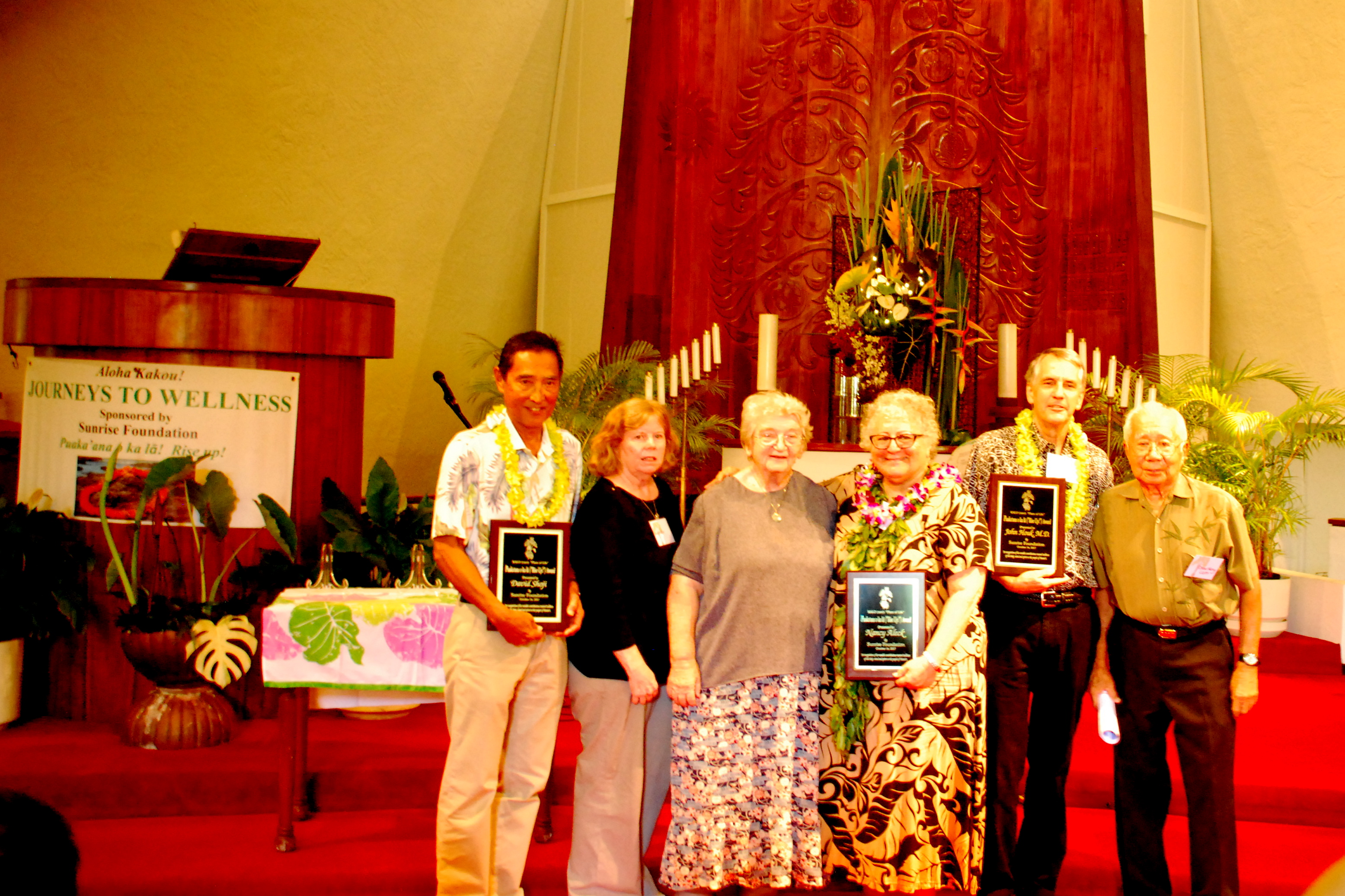 "The 2017 Puaka'ana o ka lä (Rise Up!) Award recipients with Sunrise Foundation board members at the recent ""Journeys to Wellness"" program. From left: Honoree Dave Shoji; Ann Miller; Sister Joan Chatfield, Ph.D.; honoree Nancy Aleck; honoree Dr. John Houk and the Rev. Dr. Wally Fukunaga. (Photo by Kevin Kawamoto)"