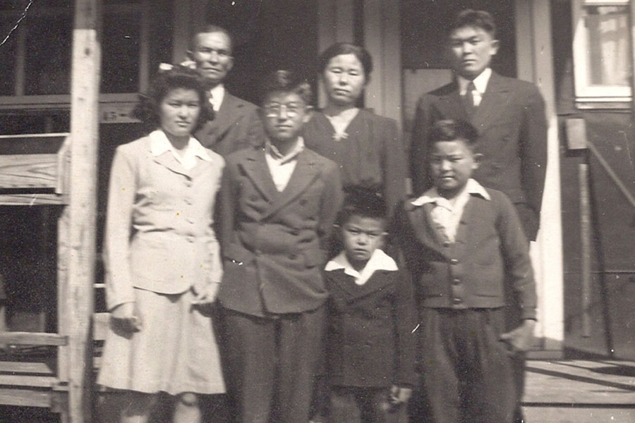 The Yogi family. Stan Yogi's father, John Yogi (back row, far right), in camp at Jerome, Ark., with his parents, uncles and aunt. (Photos courtesy Stan Yogi)