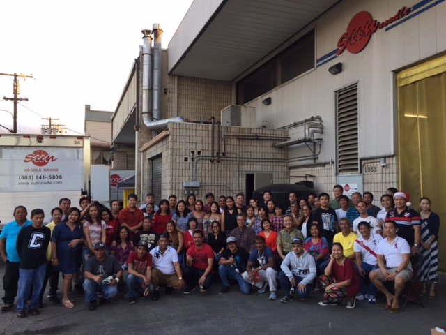 Hidehito and Keiko Uki and their Sun Noodle crew at the company's Colburn Street factory in Kalihi. (Photos courtesy Sun Noodle)