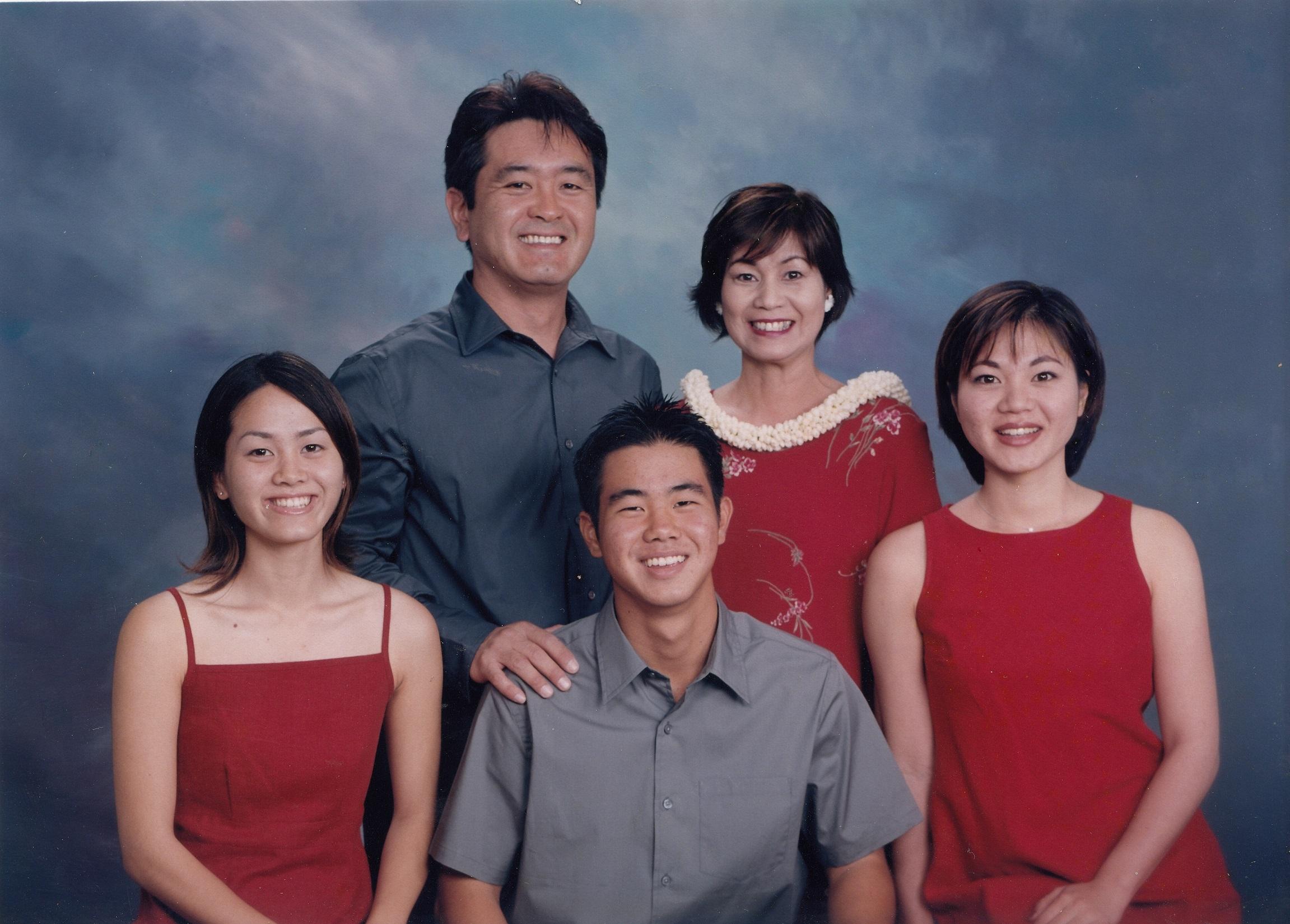 Family photo of Hidehito and Keiko Uki and their children (from left) Hisae, Kenshiro and Jamie.