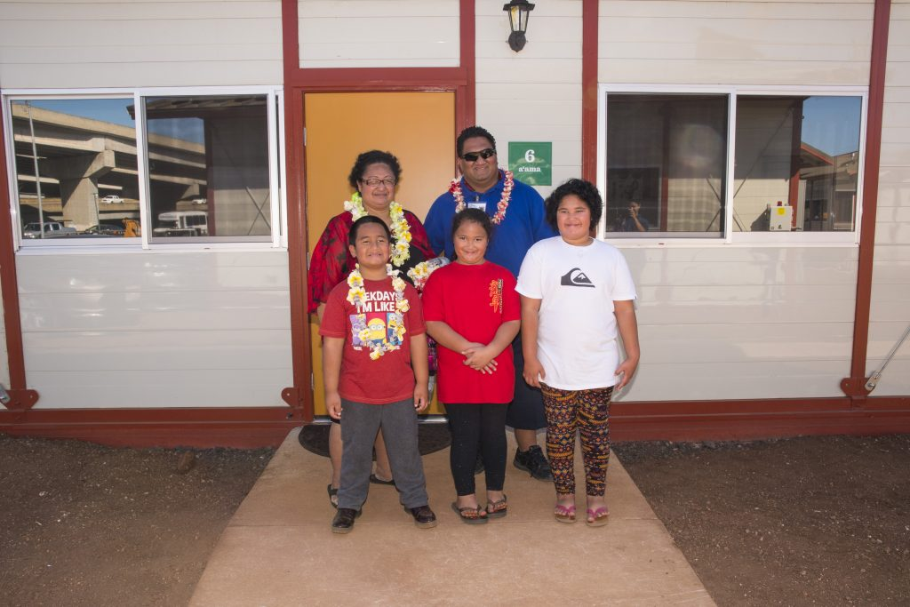 The Vaesau family — Tinu and Faa, and their children Faa Jr., Shanneyah and Parousia — in front of their home.