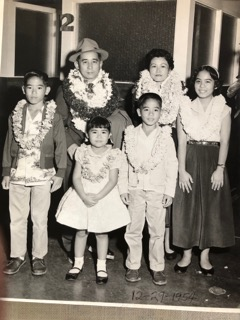 Tom and Mildred Kobashikawa and their children — (from left) Peter, Leilani, Fred and Ruby — just before boarding the plane on a family trip.