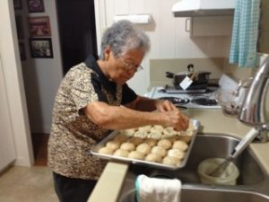 Mildred's nieces — and writer Kevin Kawamoto — say Aunty Mildred's manju is awesome. Here she is in her kitchen making manju