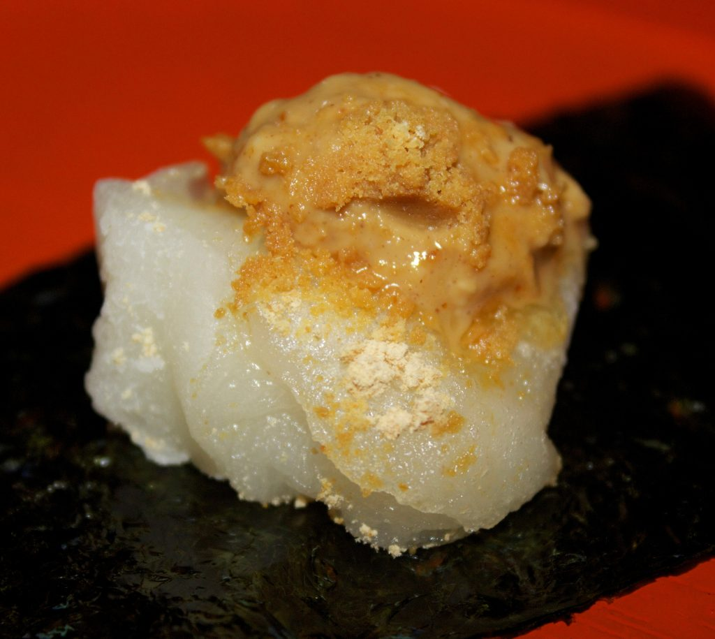Mochi topped with kinako and peanut butter.